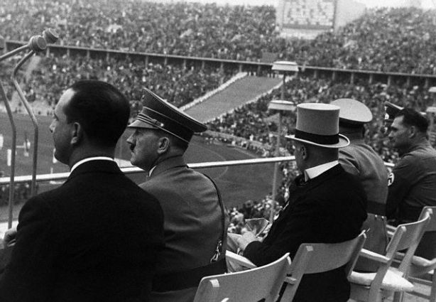 Adolf Hitler and the Crown Prince of Italy attend the Berlin Olympics in 1936. 1936 Berlin, Germany